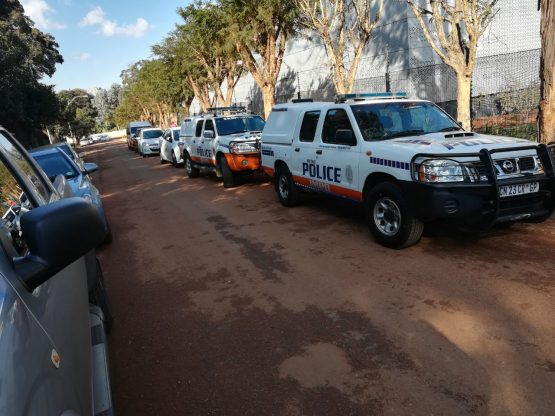 Metro police vehicles parked in front of Century Properties's student housing project on Wednesday. Picture: Supplied