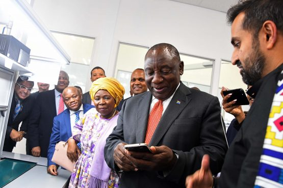 President Cyril Ramaphosa received by Minister of Trade and Industry, Mr Ebrahim Patel and Mara Group CEO, Mr Ashish Thakkar during the Mara Phones launch held in Durban.  ​ The Mara Group announced plans to manufacture affordable smartphones in South Africa at the inaugural South African Investment Conference held in November 2018.  Mara Phones will manufacture two smartphones developed in partnership with Google, as part of the Android One Program.​17/10/2019 Kopano Tlape GCIS