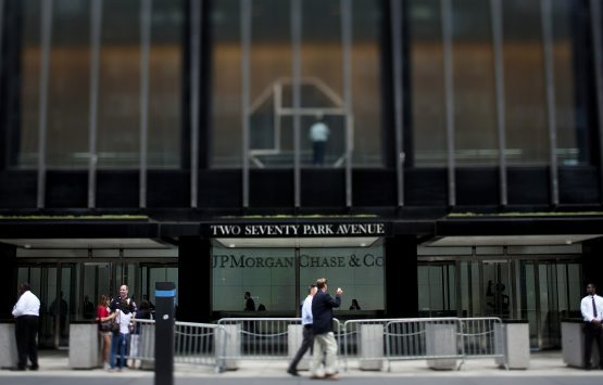 Pedestrians pass in front of the JP Morgan Chase & Co headquarters in New York. Image: Scott Eells/Bloomberg