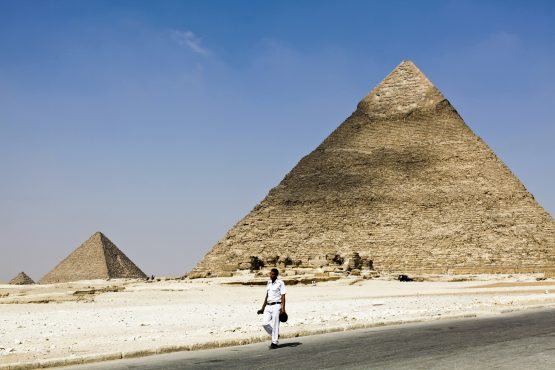 A police officer walks along a road at the pyramids of Giza complex in Cairo, Egypt. Picture: Shawn Baldwin/Bloomberg