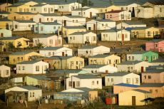 Shift in housing policy, as poor to own state land