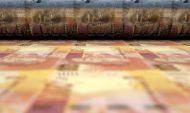 High-yielding rand gains