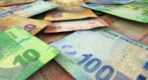 Rand extends gains after central bank surprise