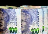 Rand rises as dollar falls before Fed rate decision
