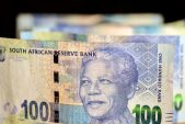 Rand retreats, Naspers lifts stocks