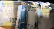Rand retreats on end-of-week profit taking, stocks inch higher