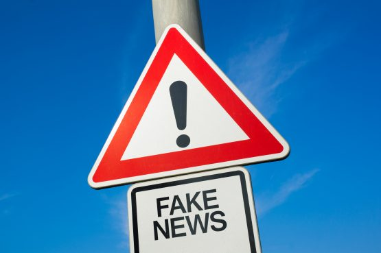 At least seven people in South Africa have been arrested for spreading fake news about coronavirus. They face a fine, six months in jail, or both. Image: Shutterstock