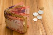 Rand inches firmer on US stimulus hopes