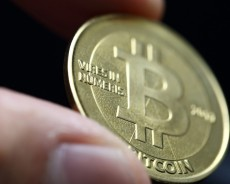 Bitcoin soars as upgrade backers hoist beers to armistice