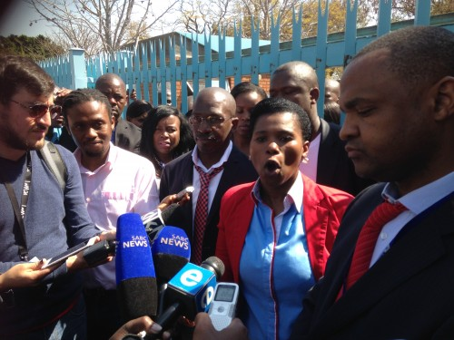 Prasa senior manager Anele Mda addresses journalists at an 'unauthorised' briefing by Prasa staff outside the organisation's offices. To her right: Prasa spokesperson Moffet Mofokeng. To her left: Senior manager in HR Sello Maluleke.