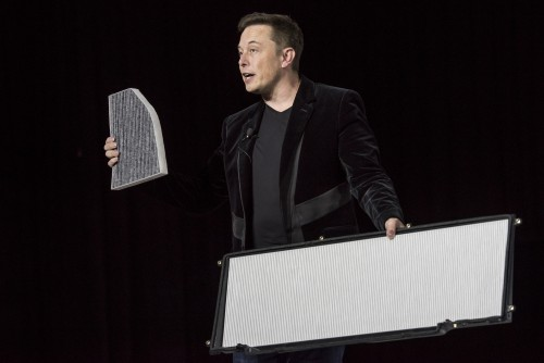 Elon Musk, chairman and CEO of Tesla Motors, holds up an air filter for the Model X SUV. Picture: David Paul Morris/Bloomberg