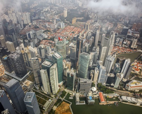 Commercial buildings in the central business district stand near Marina Bay in this aerial photograph taken above Singapore. Image: Warren Soh/Bloomberg