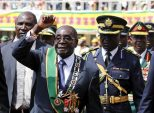 Slumped and mumbling, Mugabe denies Zimbabwe is 'fragile'