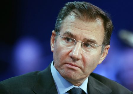 Glencore writes down coal, oil and freezes share buybacks