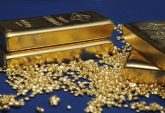 Gold less prone to turmoil as ETF cash eases price swings
