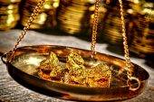 Gold seen at risk of further battering in '17 as rates to climb