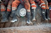 Workers down tools at Pan African's main SA gold mine