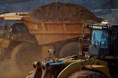 Iron ore sinks as 'peak steel' call, supply angst rattle market