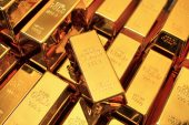 Gold drops to near ten-month low
