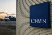 Miner Lonmin narrows first-half loss, cuts annual spending target