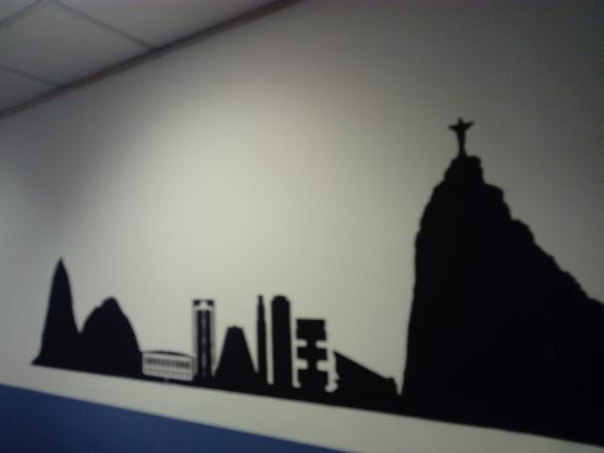 The silhouettes of different world cities that the students are learning about, cover the passage walls.
