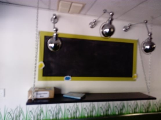 The school tuckshop board and suggestion box: in having a chance to run the tuckshops as their own businesses, teachers learn more about entrepreneurship.