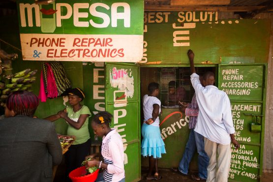 Mobile-money services such as M-Pesa relieve extreme poverty by enabling people to produce and sell goods in self-designed markets, research shows. Picture: Bloomberg
