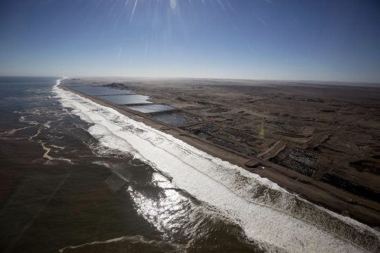 Former open pit diamond mines line the Atlantic shoreline on Namibia's southern coast. Picture: Simon Dawson/Bloomberg