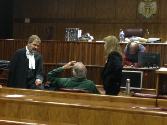 State advocate Etienne Coetzee SC talks to Tigon-accused Gary Porritt and Sue Bennett after the court adjourned on August 2, 2017. Picture: Moneyweb