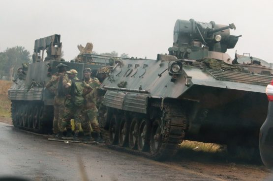 Soldiers stand beside military vehicles just outside Harare, Zimbabwe. Picture: Reuters