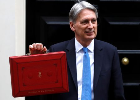 UK sees weak growth, more borrowing
