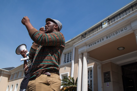 #FeesMustFall protester addresses a crowd at UCT. Picture: Ashraf Hendricks/GroundUp