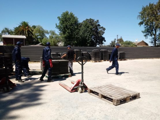 The workers at National Manhole Covers in Cape Town manually piling covers. Picture: Moneyweb