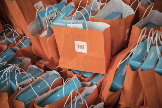 Gift bags sit stacked during the unveiling event for the Xiaomi Mi MIX 2S smartphone in Shanghai, China, on Tuesday, March 27, 2018. Picture: Qilai Shen/Bloomberg