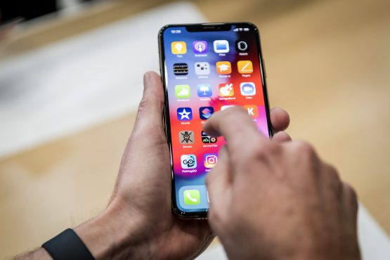 An attendee demonstrates the Apple iPhone XR smartphone during an event at the Steve Jobs Theatre in Cupertino, California on September 12, 2018. Picture: David Paul Morris/Bloomberg