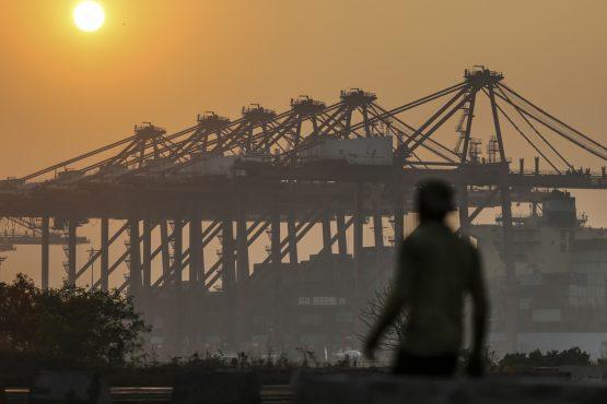 The sun sets over gantry cranes at the Jawaharlal Nehru Port in Navi Mumbai, Maharashtra, India. Picture: Dhiraj Singh/Bloomberg