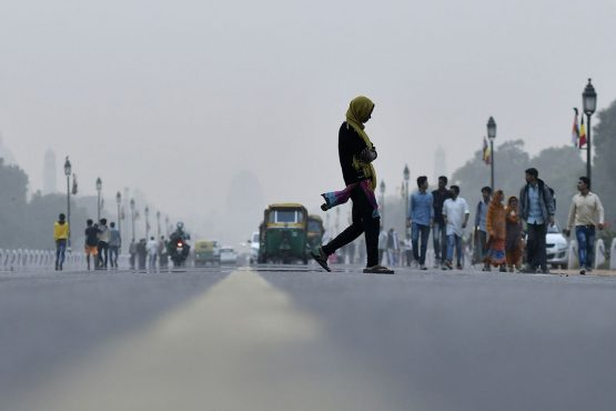 A pedestrian crosses a road in New Delhi, India. Picture: Bloomberg