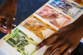 Rand firms, stocks dip 2% tracking Asia