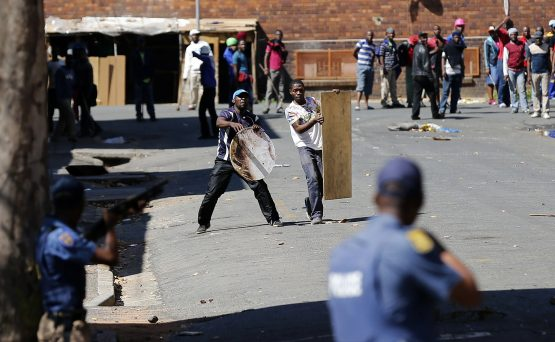Protesters throw stones at police officers during service delivery protests in Johannesburg. Picture: Siphiwe Sibeko/Reuters