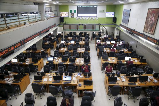 Traders take a break at the trading floor of the Nigerian Stock Exchange in Lagos, Nigeria. Picture: Reuters