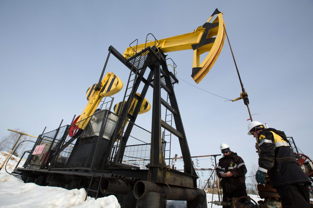 Oil pares third weekly gain
