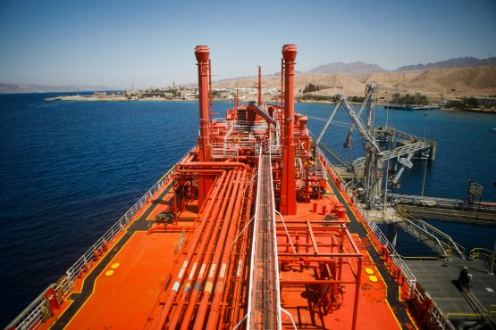The 'Eugenia Gas' LPG tanker sits beside fuel transfer pipes at a terminal at Aqaba port, operated by Aqaba Development, in Aqaba, Jordan. Picture: Annie Sakkab/Bloomberg