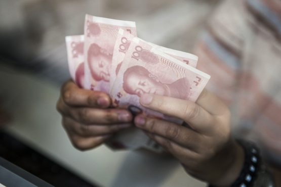 An employee at a currency exchange store counts Chinese one-hundred yuan banknotes in Hong Kong, China. Picture: Xaume Olleros/ Bloomberg