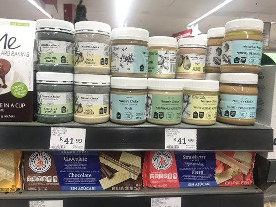 The 'Earth&Co brown rice crisp plai 100g R41,99' label clearly doesn't refer to the 250g jar of White Almond Nut Butter on the shelf above it or the 225g packet of wafer biscuits on the shelf below. The actual price? A three-digit number. Picture: Barbara Curson