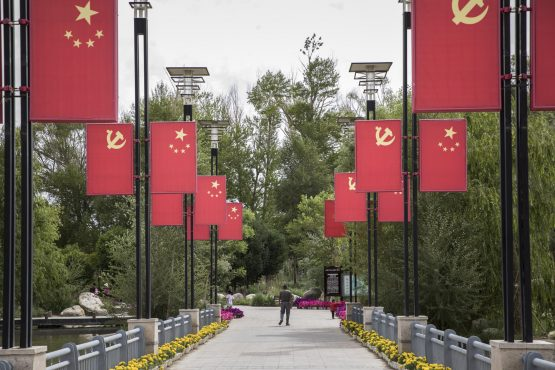 The Chinese national flag and the Chinese Communist Party flag hang on display at a park commemorating General Mu Shengzhong. Picture: Qilai Shen/Bloomberg