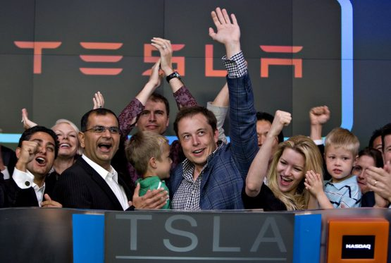 Elon Musk and Deepak Ahuja (outgoing CFO), second left. Picture: Daniel Acker/Bloomberg