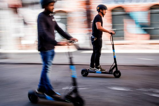 Even executives have taken to scooters, while speculating on sneakers has become a thing and workers have been treating interview callbacks like bad Tinder matches. Photographer: David Paul Morris/Bloomberg