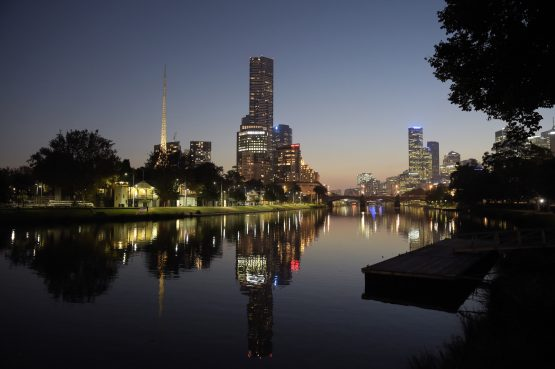 The Art Centre Spire, left, and other buildings' lights are reflected in the Yarra River in Melbourne, Australia. Image: Carla Gottgens, Bloomberg