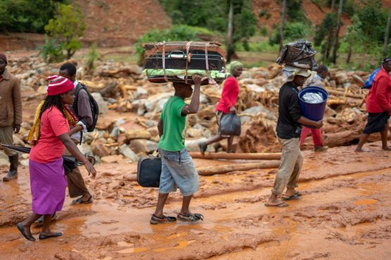 Cylone survivors leave the Ngangu township with their belongings to Chimanimani Hotel. Picture: Zinyange Auntony/AFP/Getty Images