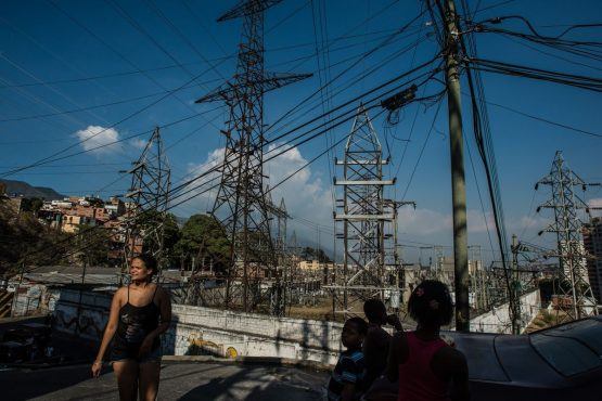 As blackout eases, rival rallies sweep Caracas